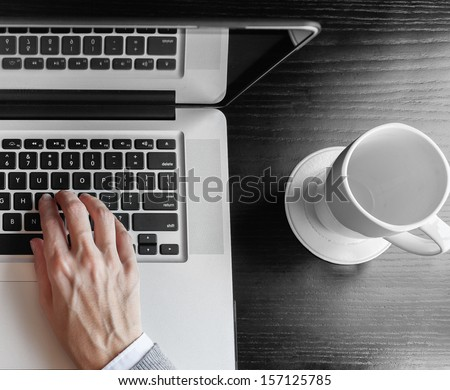 Close up of business person working on computer - stock photo