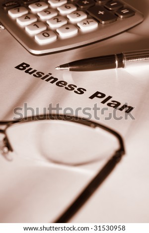 Close up of business plan differential focus sepia tone - stock photo