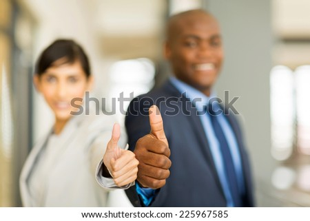 close up of business team thumbs up - stock photo