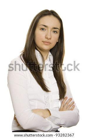Close-up of business woman in a white shirt and black skirt on white arms crossed. Isolated on a white background