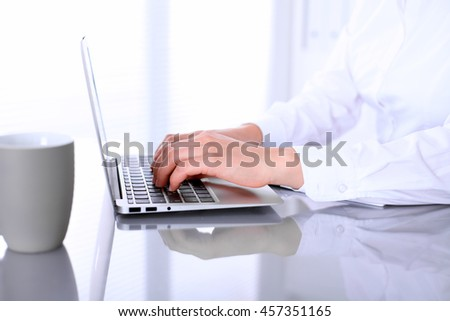 Close-up of Business woman is typing on laptop computer