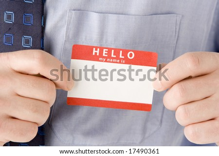 Close Up Of Businessman Attaching Name Tag - stock photo