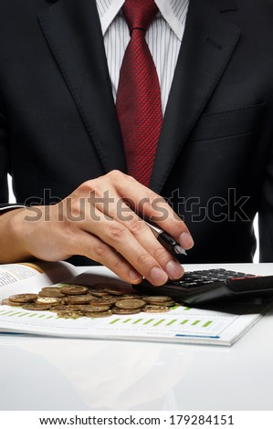 Close-up of businessman doing financial calculation - stock photo