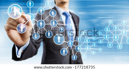 Close up of businessman drawing chain of interaction - stock photo