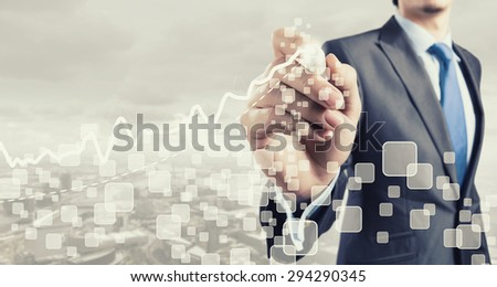 Close up of businessman drawing increasing graph with marker - stock photo