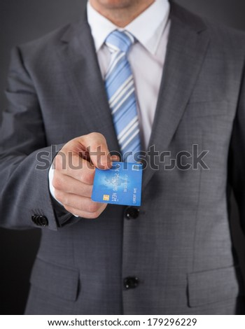 Close-up Of Businessman Giving His Credit Card  - stock photo