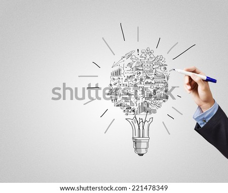 Close up of businessman hand drawing business strategy sketches