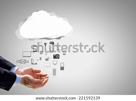 Close up of businessman hand holding cloud with media icons