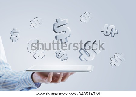Close up of businessman hand holding tablet and glass symbols
