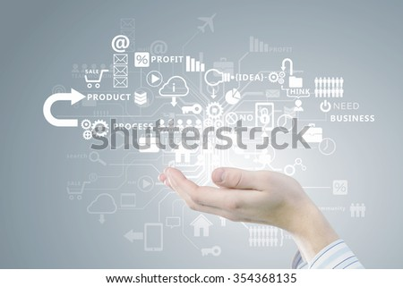 Close up of businessman hand presenting in palm digital business strategy - stock photo