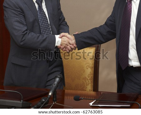 close up of  businessman hand shake - stock photo
