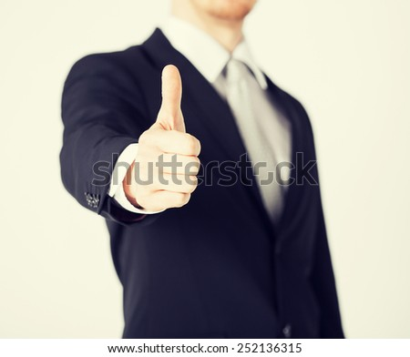 close up of businessman hand showing thumbs up