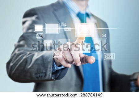 Close up of businessman hand touching icon of media screen  - stock photo