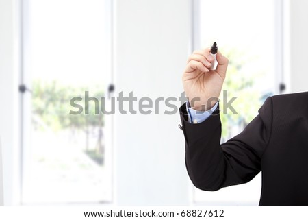 Close up of businessman hand with pen ready to write something in the office