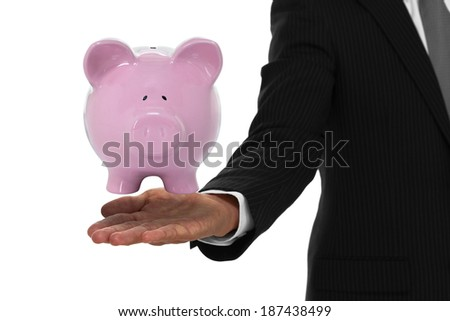 Close up of businessman hand with piggy bank floating above it