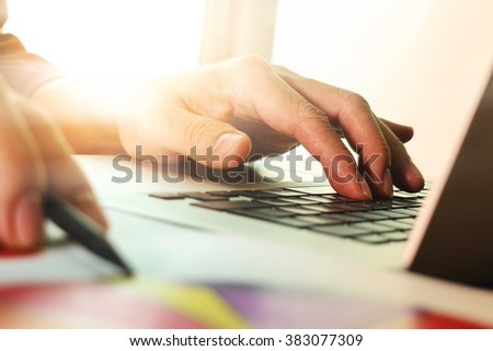 close up of businessman hand working with new modern computer
