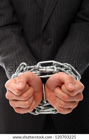 Close up of businessman hands chained over a white background - stock photo