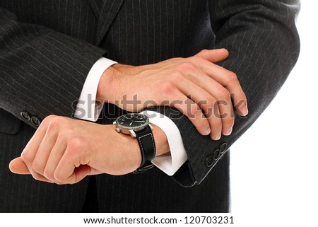 Close Up of businessman hands checking his watches over a white background - stock photo