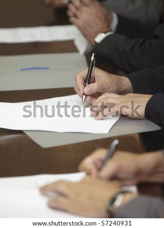 close up of businessman hands signing contract - stock photo