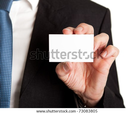 Close-up of businessman holding blank card