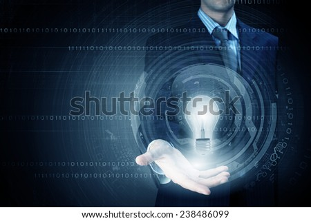 Close up of businessman holding bulb in palm