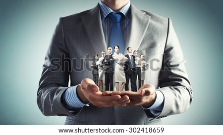 Close up of businessman holding in hands successful business team - stock photo