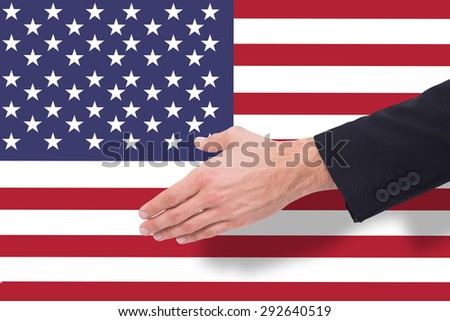 Close up of businessman offering handshake against marble surface