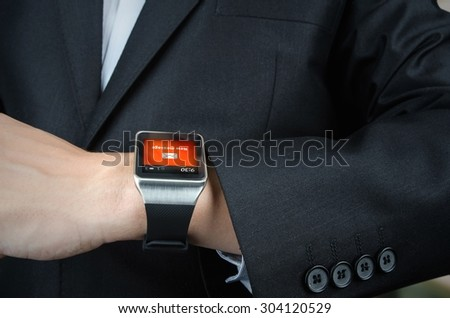 Close up of businessman receives message notification on smart watch