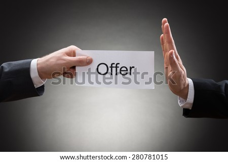 Close-up Of Businessman's Hand Holding Paper With Advice Word On It - stock photo