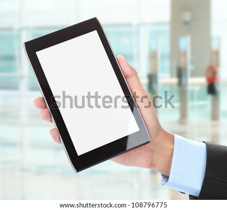 close up of businessman's hand holding tablet - stock photo
