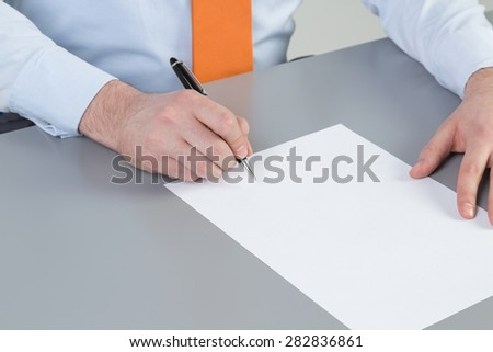 Close up of businessman's hand intending to write a document, petition or claim. A concept of drafting documentation process. Signing the legal document. - stock photo