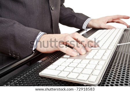Close-up of businessman's hand touching computer keys during work