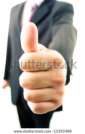 Close-up of businessman's thumb up after making a deal