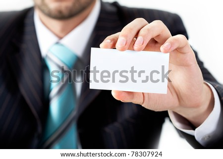 Close-up of businessman showing blank visiting card in his hand - stock photo
