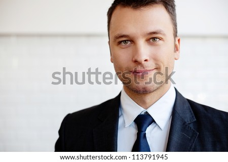 Close-up of businessman smiling. - stock photo