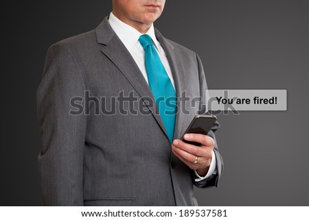 Close up of businessman text messaging on cell phone
