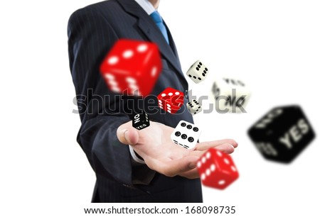 Close up of businessman throwing dice. Gambling concept - stock photo