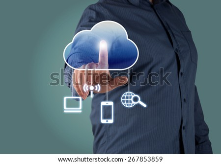 Close up of businessman touching cloud icon with finger