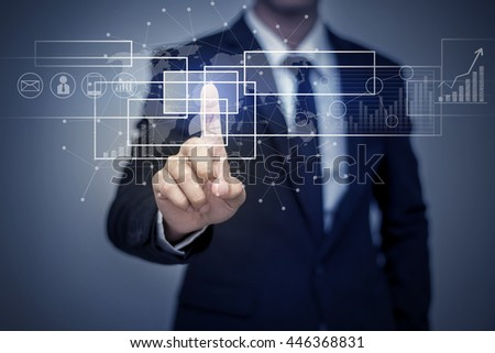 Close up of businessman touching digital screen with finger - stock photo