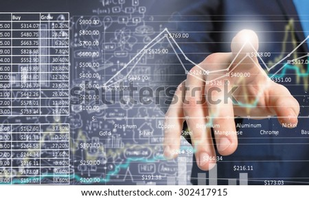 Close up of businessman touching increasing graph on media screen - stock photo