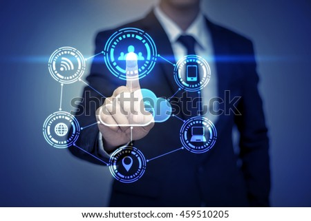 Close up of businessman touching social media icon on virtual screen - stock photo