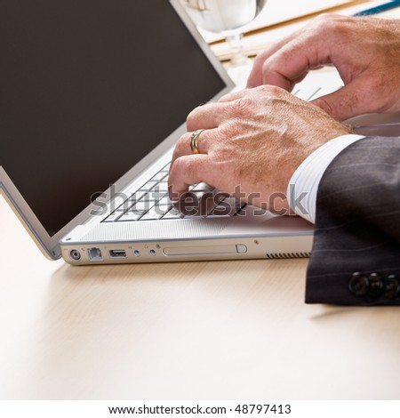 Close up of businessman typing on laptop - stock photo