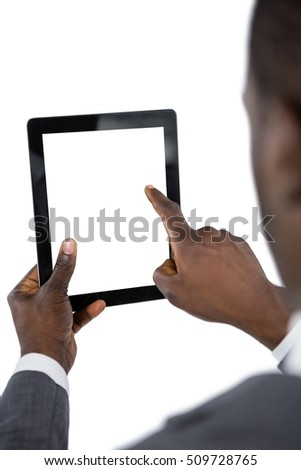 Close-up of businessman using digital tablet against white background