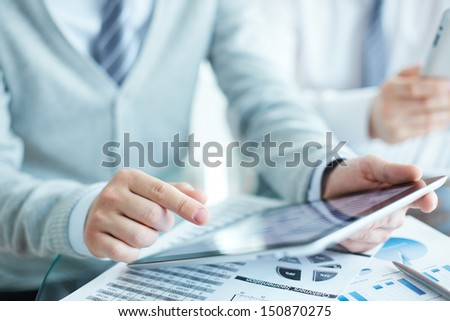 Close-up of businessman using touchpad
