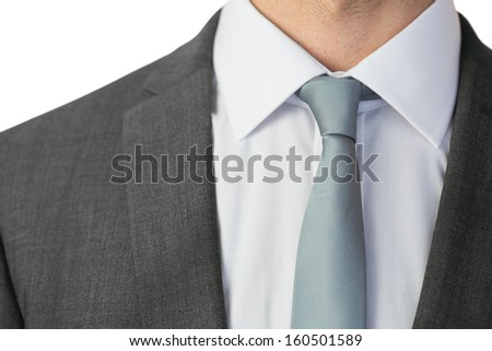 Close up of businessman wearing a tie on white background