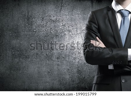 Close up of businessman with arms crossed on chest - stock photo