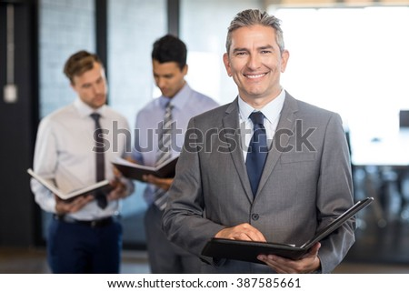 Close-up of businessman with his organizer in the office - stock photo
