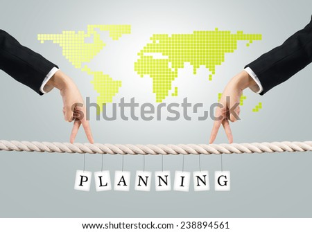 Close up of businessmen hands walking with fingers on rope