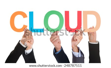 Close-up Of Businesspeople Hands Holding The Word Cloud Over White Background - stock photo