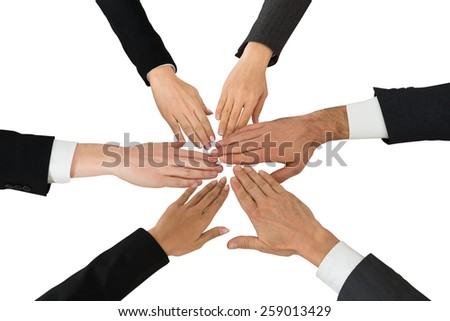 Close-up Of Businesspeople Hands Over White Background - stock photo